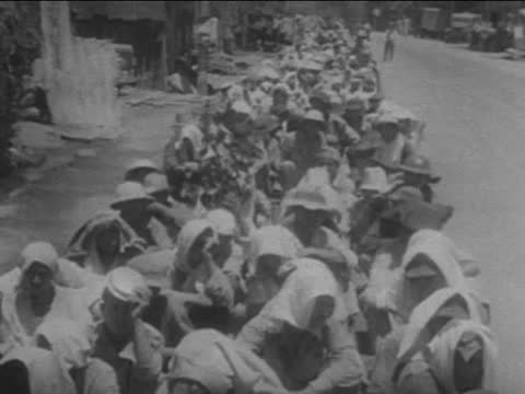 american and pilipino prisoners of war marching in column for seven days without food or water, suffering from sun - 1942 stock videos & royalty-free footage