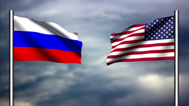 American and Russian flags waving against each other