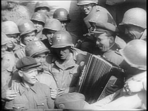 american and russian soldiers meet / troops drink and sing together / poster depicts unity of armies / men of american and russian troops shake hands. - 1945 stock videos & royalty-free footage