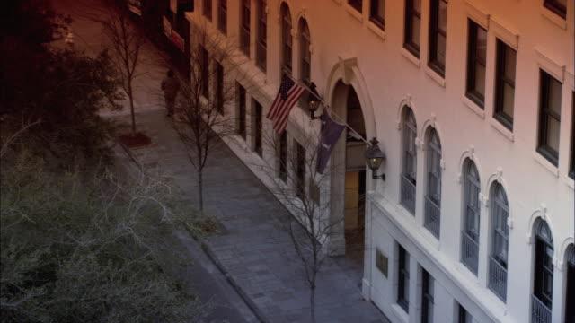 ZI American and South Carolina flags flying over school entrance / North Charleston, South Carolina, United States