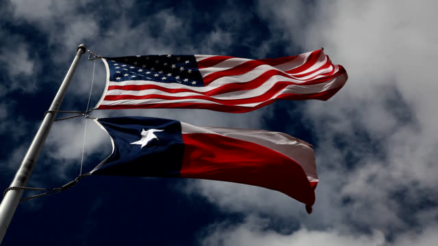 american and texas flags waving in the wind - flag blowing in the wind stock videos & royalty-free footage