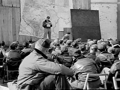 american bomber plane crews receive instructions at their base before air raid - air raid video stock e b–roll