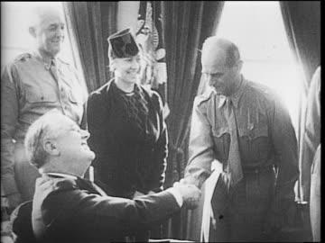 american brigadier general james h doolittle wearing a congressional medal of honor / doolittle receiving medal from president franklin d roosevelt... - medal stock videos & royalty-free footage