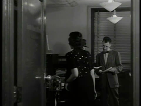 stockvideo's en b-roll-footage met american broadcasting company newsroom door woman opening door radio commentator walter winchell going over papers w/ paul scheffels - abc broadcasting company
