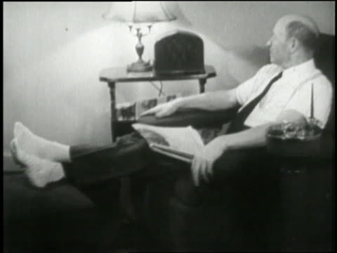 american citizens listen to u.s. president franklin d. roosevelt's fireside chat concerning america's banking system. - 1933 stock videos & royalty-free footage