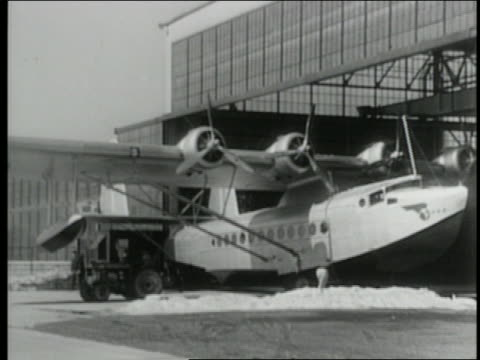 american clipper plane being towed out of hangar - 1931 stock videos & royalty-free footage