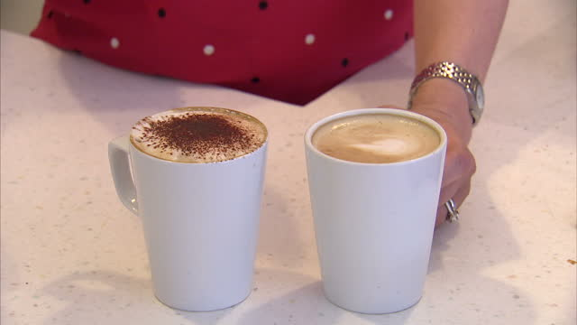 american coffeelovers will soon have to change their order after the starbucks chain announced it's to take the classic cappuccino off the menu the... - coffee drink stock videos and b-roll footage