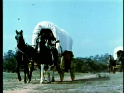 1963 REENACTMENT MONTAGE American colonists arriving by covered wagon to settle in Texas / AUDIO / 1820s Texas / AUDIO
