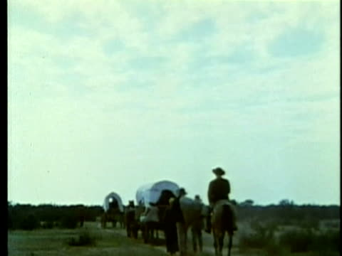 1963 reenactment ws american colonists arrivng by covered wagon convoy to settle in texas / audio / 1820s texas / audio  - 19th century stock videos & royalty-free footage