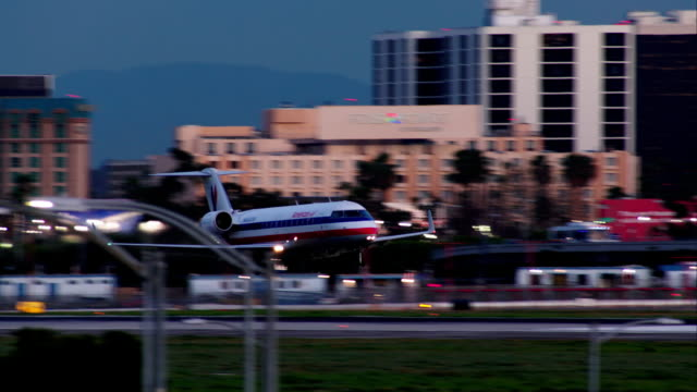 American Eagle Bombardier CRJ-200ER landing at Los Angeles International Airport, late afternoon.