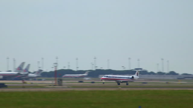 pan american eagle commuter jet (embrear erj) takes off with airport terminal and tower in background/dfw international airport, dallas-fort worth, texas, usa - dallas fort worth airport stock videos & royalty-free footage