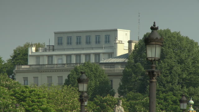 ms american embassy over tree tops, paris, france - us embassy stock videos & royalty-free footage