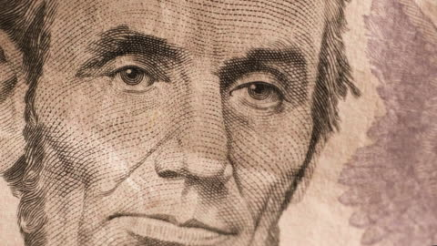 american five dollar bill and face of abraham lincoln - male likeness stock videos & royalty-free footage