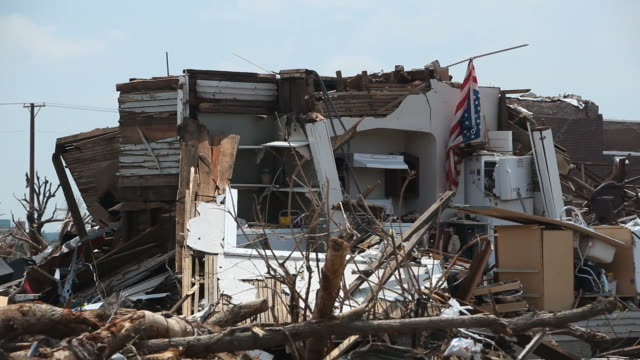 american flag amidst rubble and destruction from joplin tornado - rebuilding stock videos & royalty-free footage