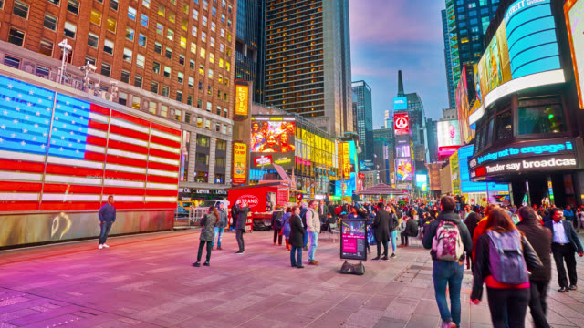 american flag and many colorful billboards, advertising american companies. people, tourists walking, taking pictures. evening illumination. - commercial sign stock videos & royalty-free footage