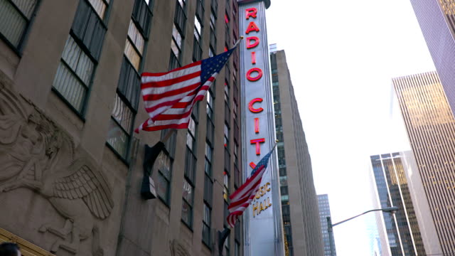 american flag and radio city music hall - radio city music hall stock videos & royalty-free footage