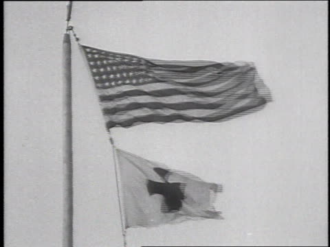 stockvideo's en b-roll-footage met american flag and red cross flag waving in the wind / camp sherman chillicothe ohio united states - chillicothe