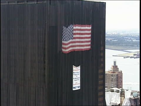 MS, ZI, CU American flag and tribute sign hanging on covered building near Ground Zero, New York City,