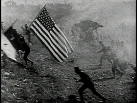 REENACTMENT American flag being carried by US Army Rough Riders during a recreation of Battle of San Juan Hill during the 1898 Spanish American War / Cuba