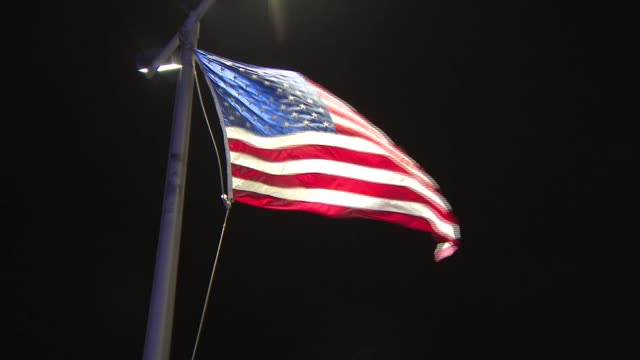american flag blows in the wind as a nor'easter approaches nyc - us flag stock videos and b-roll footage