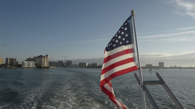 American flag blows in the wind on a boat