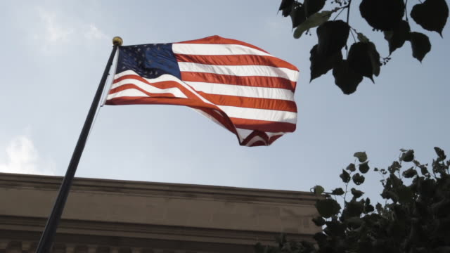American Flag blows in the wind on a warm summer day.