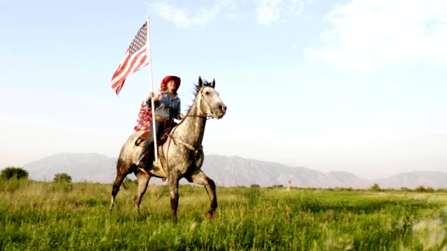 american flag cowgirl - fourth of july stock videos and b-roll footage