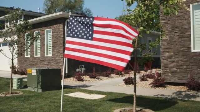 American Flag Displayed in a Neighborhood