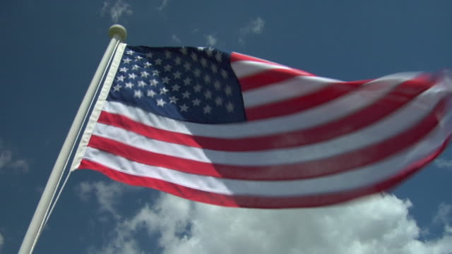CU, LA, American flag flapping against sky