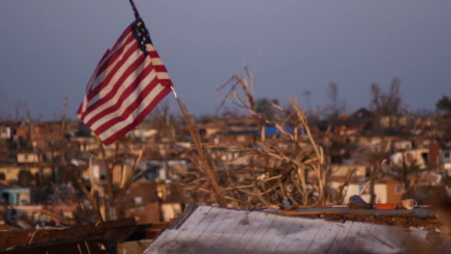 stockvideo's en b-roll-footage met american flag flown in a natural disaster 2 - beschadigd