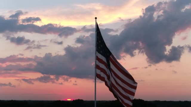american flag flying against sky at sunset - pole stock videos & royalty-free footage