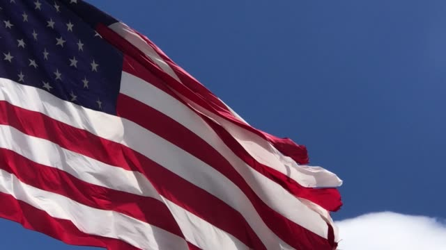 usa american flag flying in western colorado early spring outdoors - military stock videos & royalty-free footage
