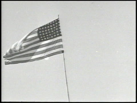 american flag flying on pole angled ws general richard sutherland general douglas macarthur unidentified officer walking w/ unidentified entourage of... - douglas macarthur stock videos and b-roll footage