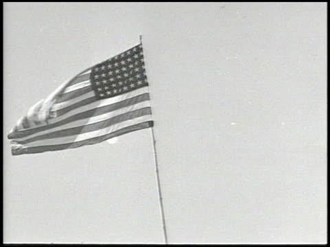 stockvideo's en b-roll-footage met american flag flying on pole angled ws general richard sutherland general douglas macarthur unidentified officer walking w/ unidentified entourage of... - douglas macarthur