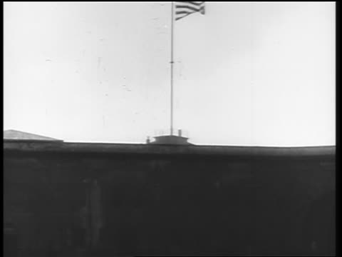 American flag flying over building at end of World War I / Germany / newsreel