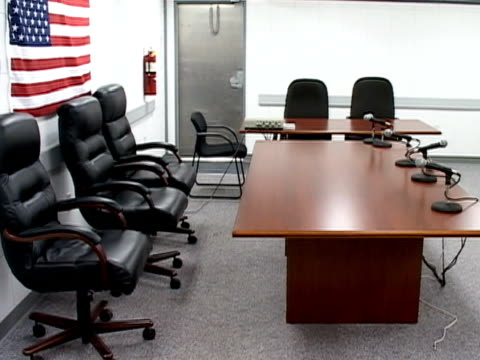 american flag hanging in empty courtroom at guantanamo bay detention center/ guantanamo province cuba - guantanamo bay stock videos & royalty-free footage