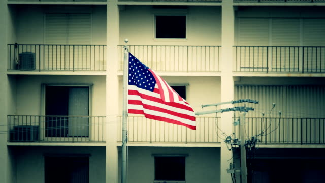 American flag in front of apartment housing