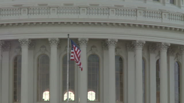 american flag in front of us capitol building dome on february 13 2011 in washington dc - united states congress stock videos & royalty-free footage