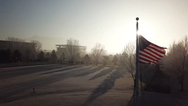 American flag in mist
