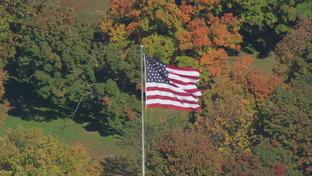 aerial american flag in parkland with fall trees / springfield, massachusetts, united states - springfield massachusetts stock videos & royalty-free footage