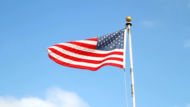american flag in the wind - pole stock videos & royalty-free footage