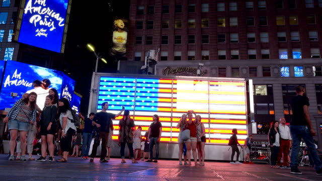 american flag in times square, new york city - top video stock e b–roll