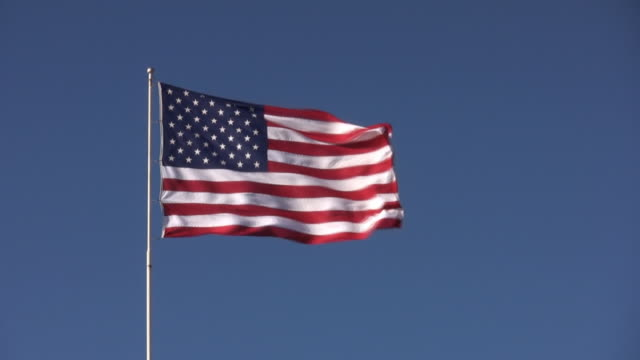 american flag in wind - pole stock videos and b-roll footage
