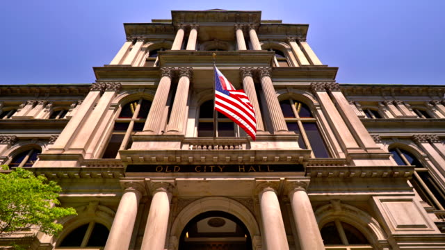 american flag on the old city hall building in boston - government building stock videos & royalty-free footage