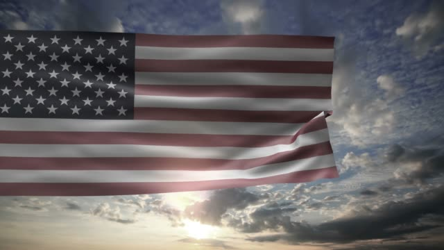 American flag on the sky with clouds and sun