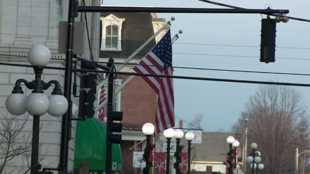 ms american flag outside building / rutland, vermont, usa - vermont stock videos & royalty-free footage