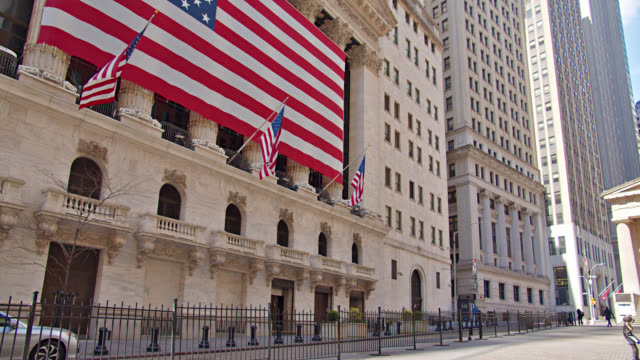 american flag raised on stock exchange on wall street. - exchange rate stock videos & royalty-free footage