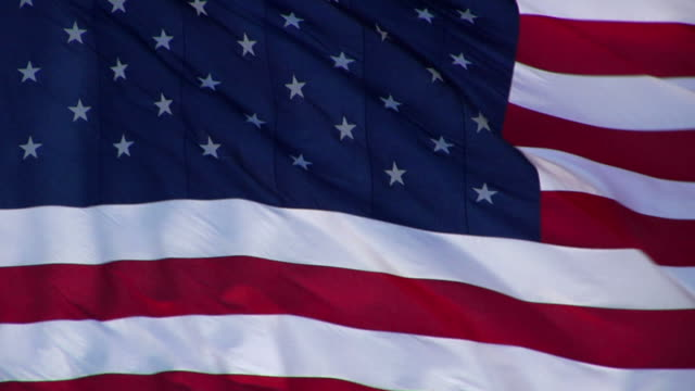 american flag slow-motion tight shot - us marine corps stock videos & royalty-free footage