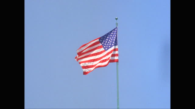 MS American flag waving against clear sky / New York City, New York State, United States