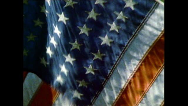 vídeos y material grabado en eventos de stock de cu of american flag waving in the wind; 1985 - patriotismo